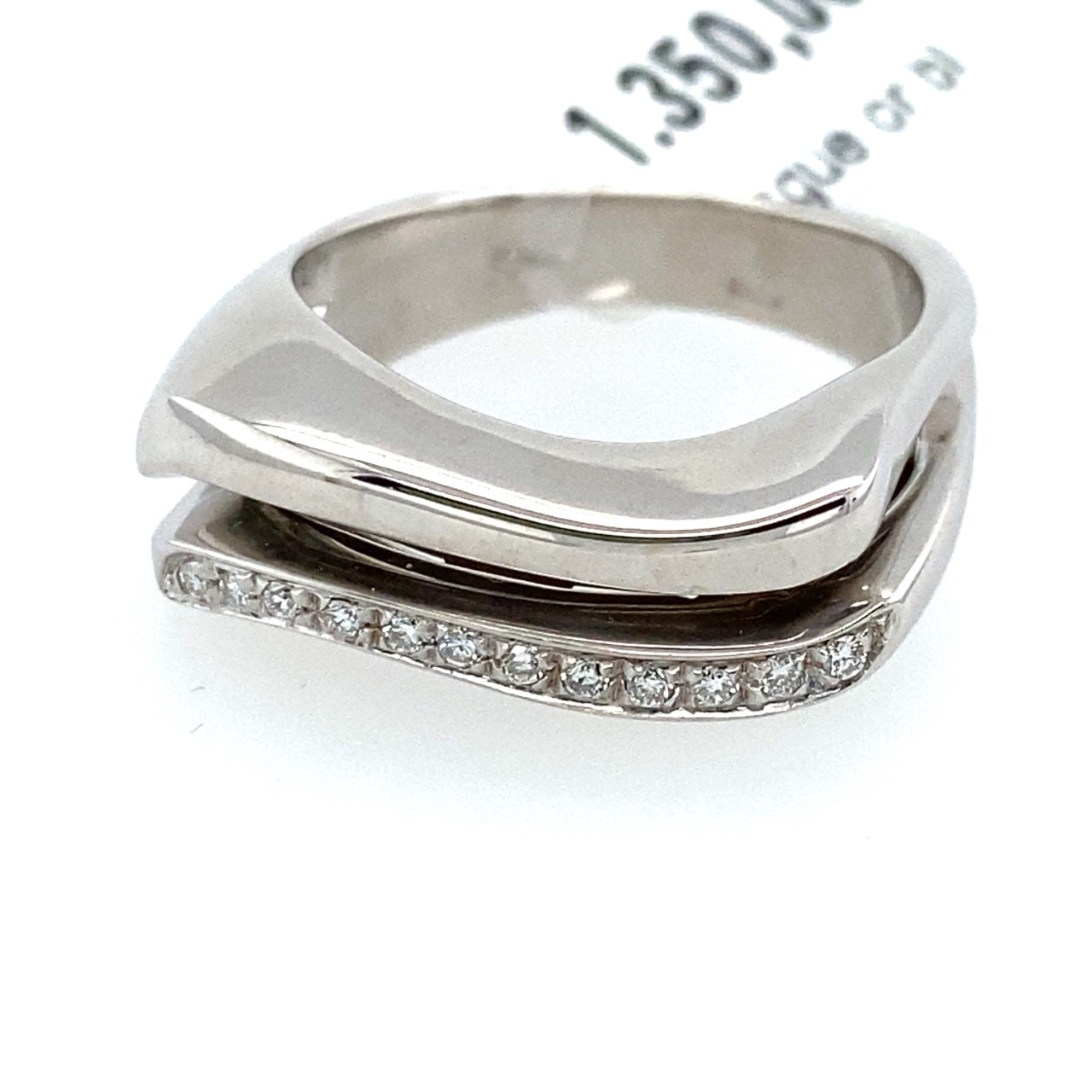 Handmade curved cut white gold ring with diamonds